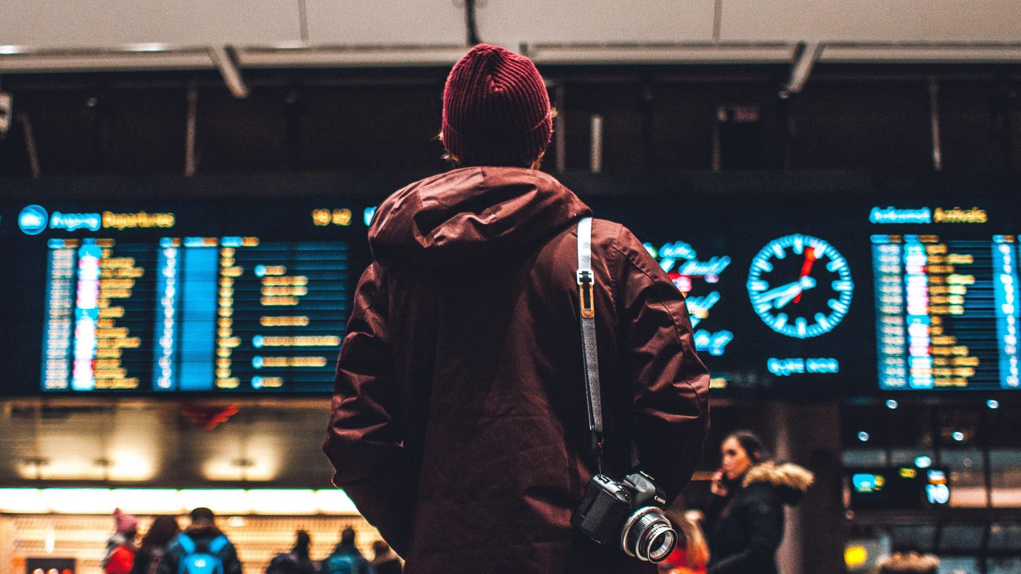 Man looking at flight boards