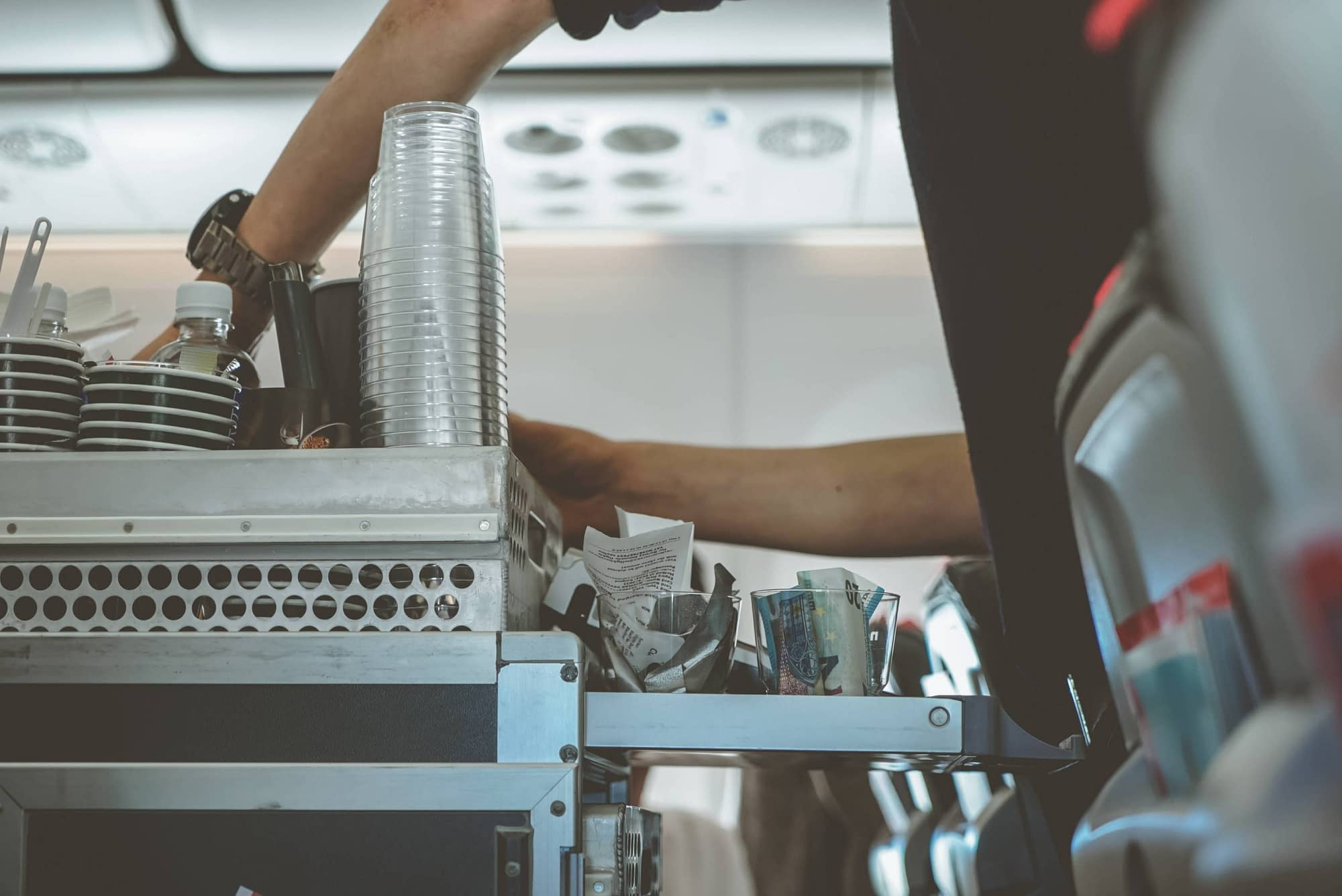 A flight crew working their in flight service during a flight.