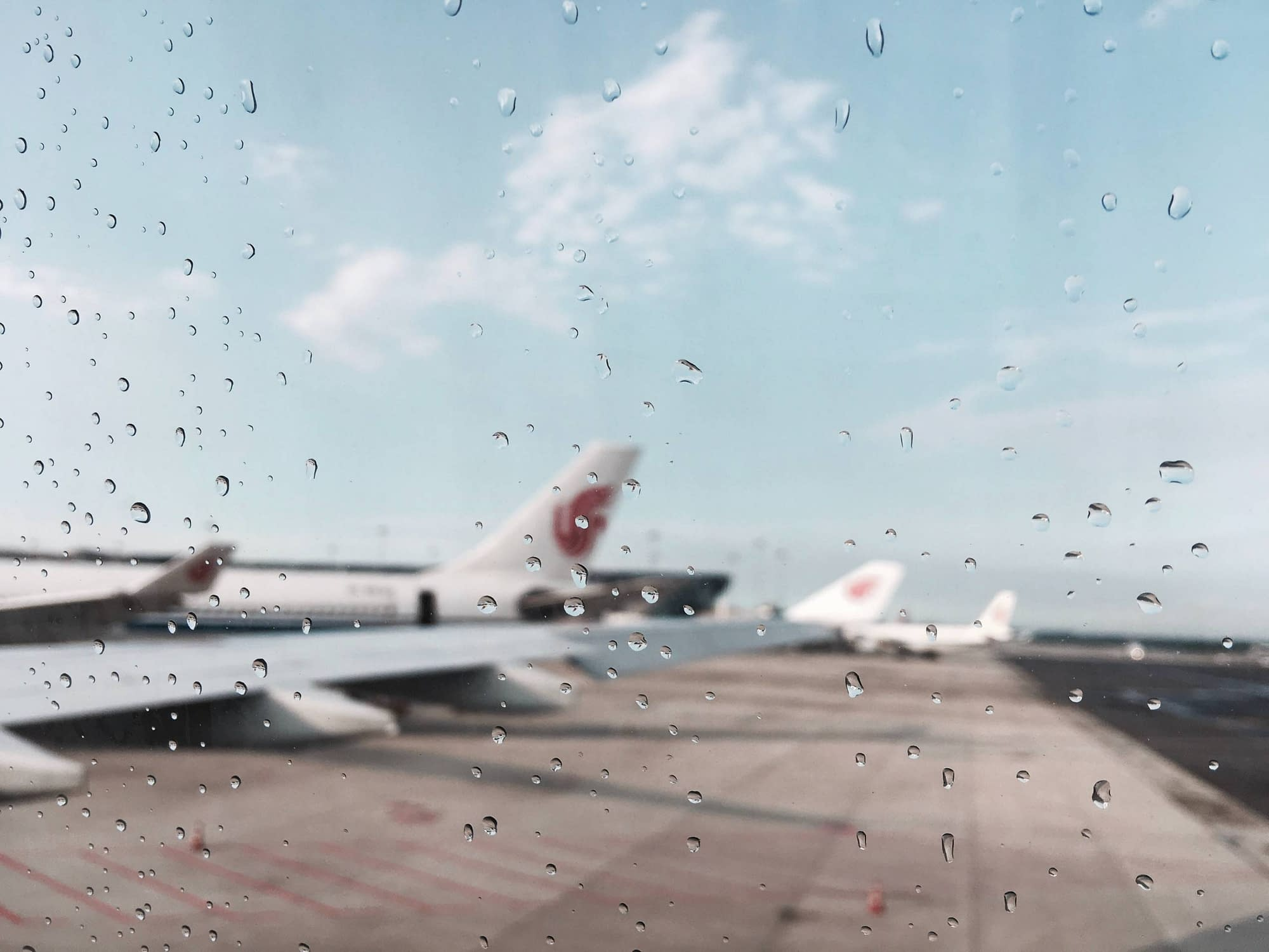 Airplanes through wet window