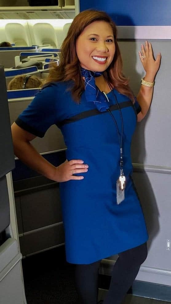 A picture of Dianne working as a Flight Crew member.
