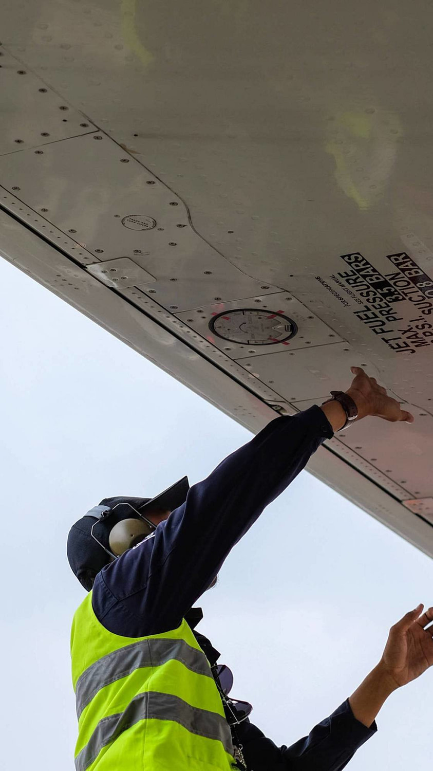 An aircraft maintenance technician working to maintain the safety of the aircraft.