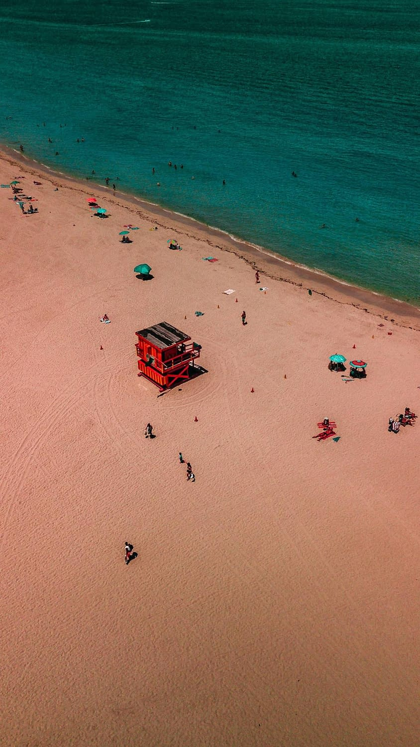 Drone shot of South Beach in Miami with the Iconic Pink Life Guard shack