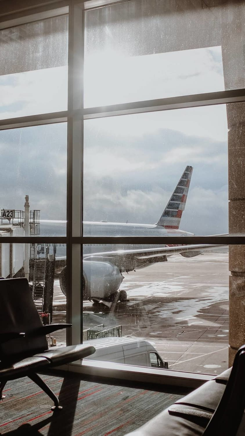 An American Airlines aircraft sits at gate A23 in their DFW Hub.