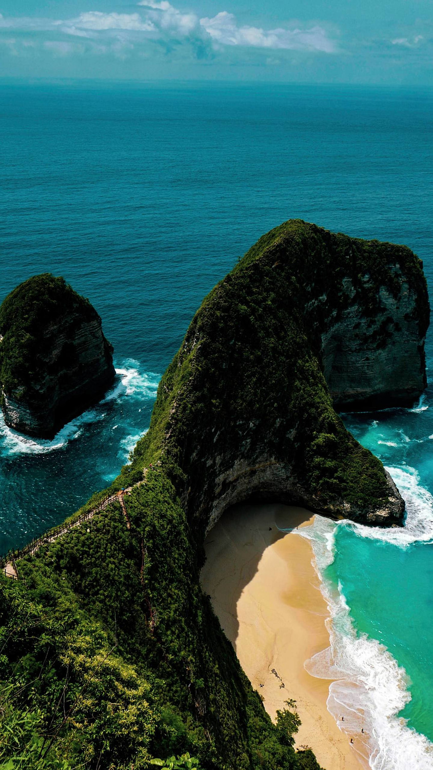 A stunning shot of a cliff and beach in Bali!