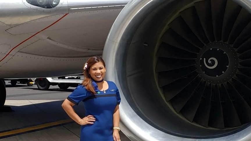 United Flight Crew member Dianne posing infront of an A320F engine
