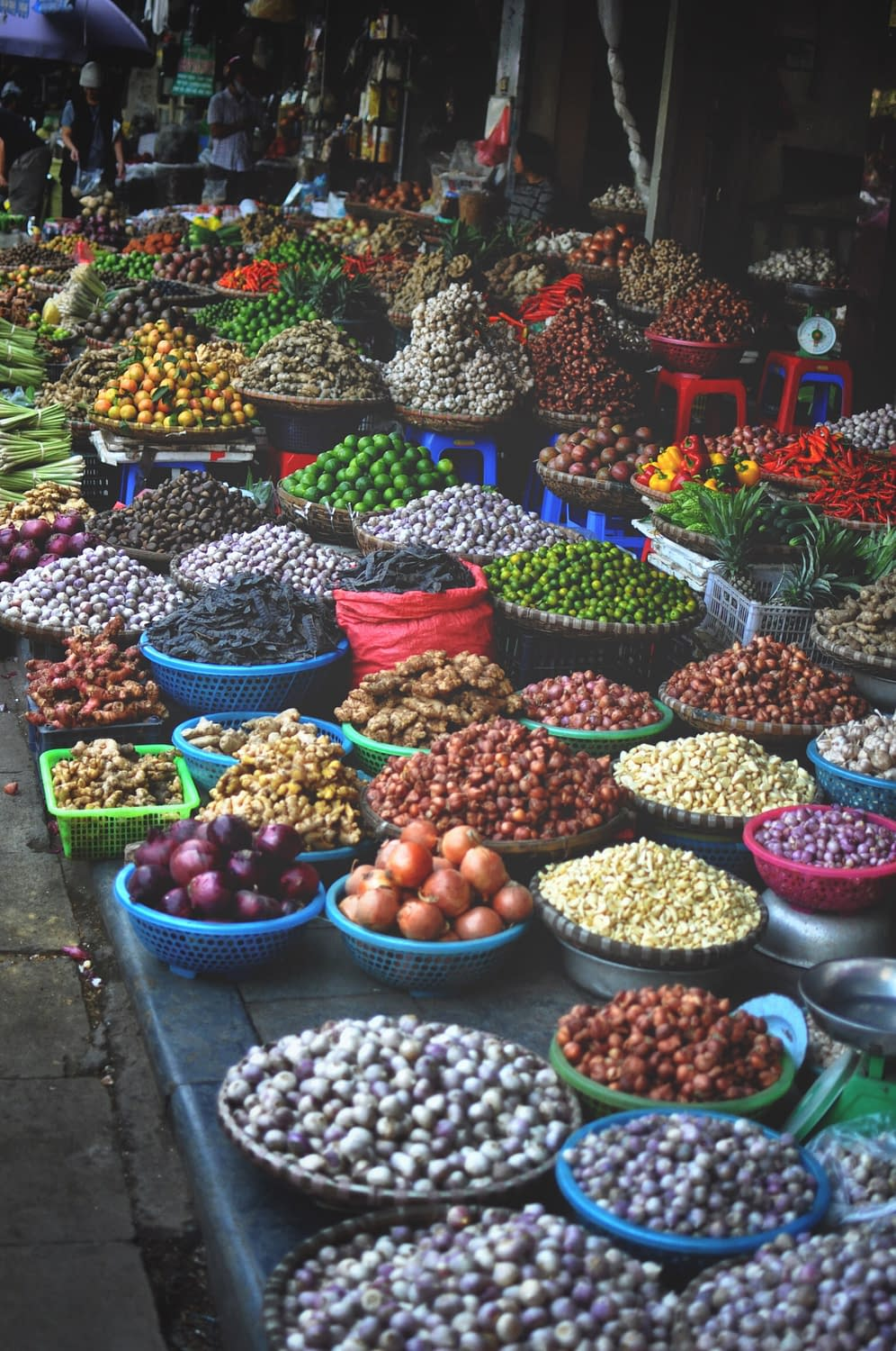 A fresh market on the streets of Hanoi, Vietnam featuring fruit, vegetables and endless food